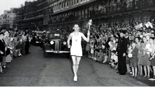 Petty Officer (Barney) Barnes, bearing the Olympic along Dover Front on the first stage of its journey to Wembley