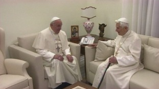 Pope Francis joins his predecessor in the sitting room of Benedict's retirement home.