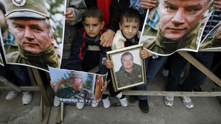 Children hold pictures of Bosnian Serb wartime general Ratko Mladic during a protest in support of Mladic in Kalinovik.