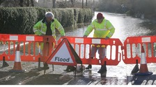 A road is closed off in Fladbury, Worcestershire, due to flooding