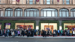 Shoppers wait outside Harrods for the start of the Boxing Day sales.
