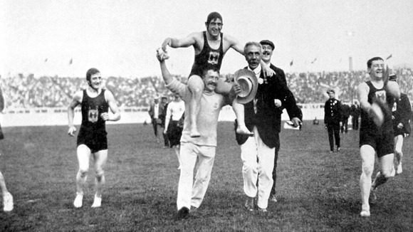Great Britain's Henry Taylor is carried shoulder-high around the White City stadium after winning gold in the 1908 Olympics