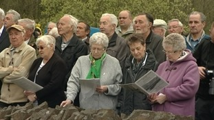 People at memorial service