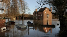 Cropthorne Mill is surrounded by floodwater from the River Avon in Fladbury, Worcestershire, after heavy rain