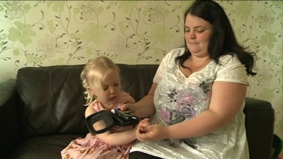 Jodie Steed testing her daughter Olivia's blood sugar levels 