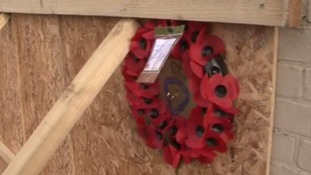 A poppy wreath has been left by the club members in honour of the driver of the lorry