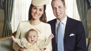 The Duke and Duchess of Cambridge with their son Prince George at his christening.