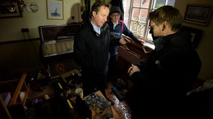 David Cameron visits a flood-affected resident in Yalding, Kent