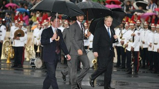 David Beckham (centre) and Mayor of London Boris Johnson (right) during the official handover ceremony of the Olympic Flame