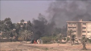 Muslim Brotherhood supporters set fire to two buildings amid clashes with police at a Cairo university.