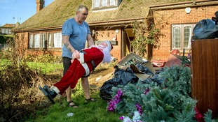 Sean Matthews clears Christmas decorations and personal belongings from his home in Yalding, Kent.