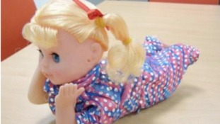One of the 'crawling'-style baby dolls