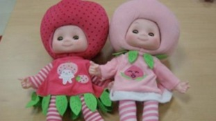 A strawberry and a raspberry 'fruit-head' doll