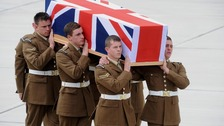 Soldiers carrying coffin