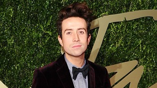 Radio 1 DJ Nick Grimshaw wearing a bow tie and a suit.
