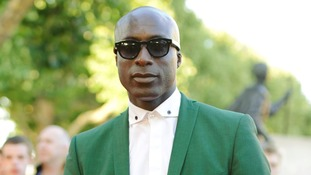Fashion designer Ozwald Boateng in a bright green suit.