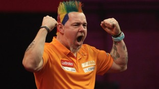 Peter Wright celebrates victory over Wes Newton.