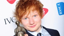 Ed Sheeran shows off his prize at London's Grosvenor House Hotel.