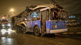 The bus destroyed in an explosion in the Russian city of Volgograd is towed away.