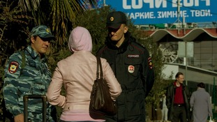 Russian police check a passerby in Sochi.