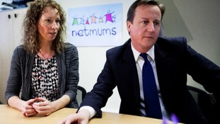 Sally Russell photographed with Prime Minister David Cameron in 2012.