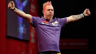 Peter Wright celebrates his 6-2 win over Simon Whitlock.
