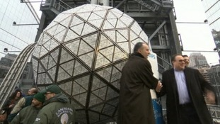 Organisers stand before the redesigned Times Square ball