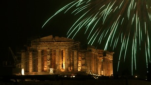 Fireworks explode over the temple of the Parthenon atop the Acropolis hill in Athens.