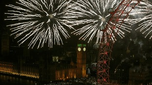 Big Ben is seen through the fireworks in London.