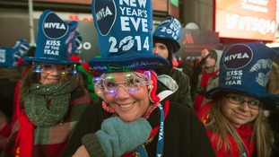 Party-goers prepare for New Year in New York's Times Square.