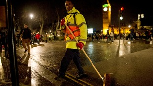 The clean up begins in central London after the New Year celebrations.
