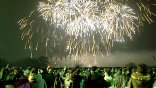 Revellers in North Korea watch the fireworks display.