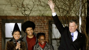 The newly sworn-in New York City Mayor Bill de Blasio waves with his wife Chirlane McCray and children Dante and Chiara.