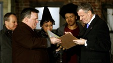 New York City's new mayor Bill de Blasio (right) signs the oath of office.