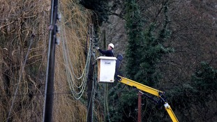 A workman works on repairing electricity lines near Reigate in Surrey