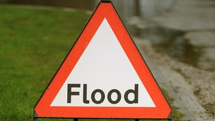 A flood sign on a road in Berkshire.
