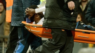 Tottenham Hotspur's Emmanuel Adebayor leaves the field injured on a stretcher