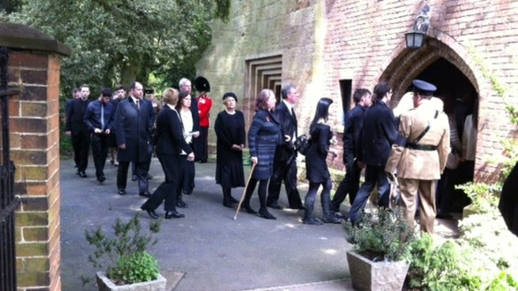Mourners gathering at the funeral of Guardsman Michael Roland in Tollerton, Nottinghamshire
