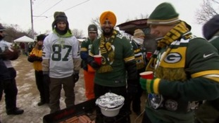 Fans have a barbecue amid some of the lowest temperatures in decades