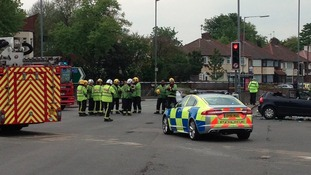 Fire crews and police at scene of A38 crash