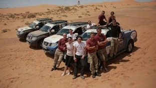 The team and the specially-adapted Navara pickup trucks