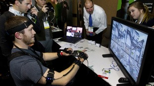 A man tests a virtual reality gaming accessory which translates his movements into the video game