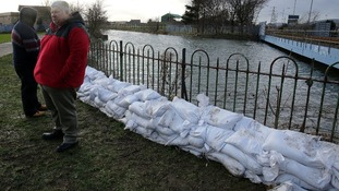 Temporary flood defences at the Connswater River in Belfast at high tide