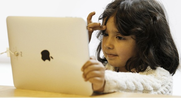 A young girl views the new iPad tablet at the Apple store in London in 2010.