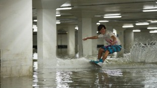 Wakeboarders use flooded car park as playground