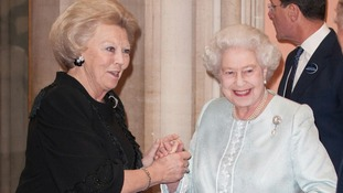 Queen Elizabeth II greets the Queen of the Netherlands at the Jubilee lunch