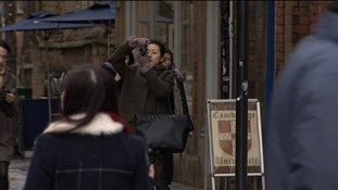 A tourist tries to get a picture of the Prince today, but he was largely left alone.