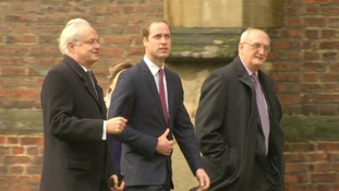 Prince William looks around St John's College.
