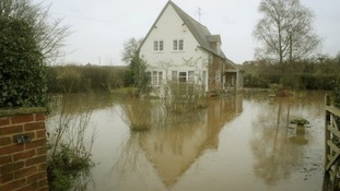 A flooded property near Apperley in Gloucestershire
