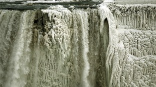 Part of the roaring waterfall frozen over